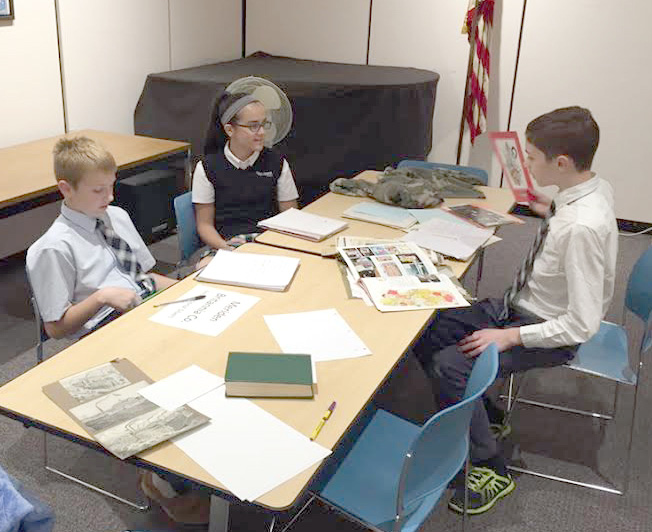 Liam, Lilli and Zachary research the International Silver Company. Thank you Michelle Baker for organizing all the literature.
