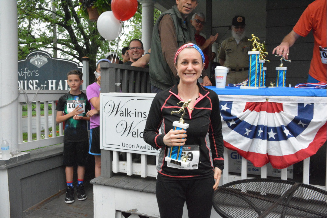 Second place winner Joy Battista posing with her newly won Meriden Memorial Mile trophy. | Ariana D