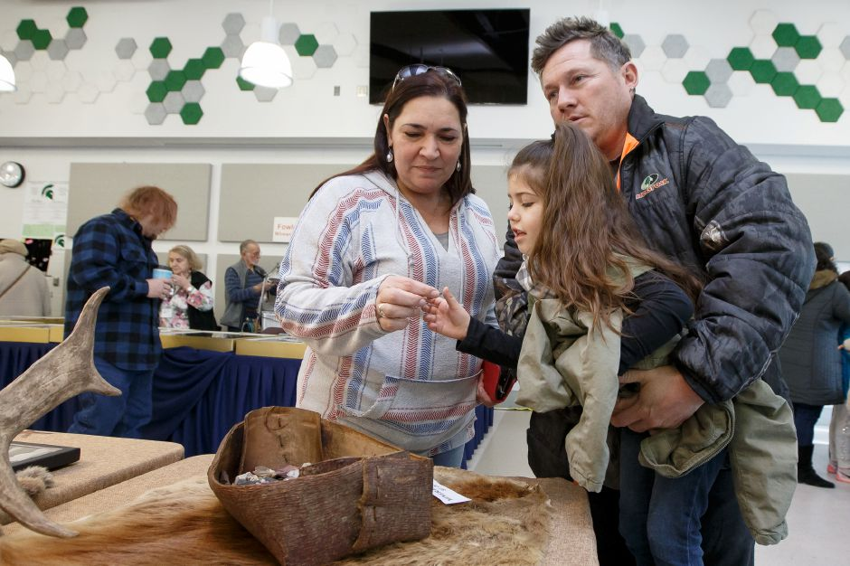 Adriana Angueira, 4, of Wallingford, gets help from her grandmother and grandfather, Jeff and Lori Darling, getting a closer look during the 47th annual Meriden Gem Show sponsored by the Lapidary & Mineral Society of Central Connecticut.