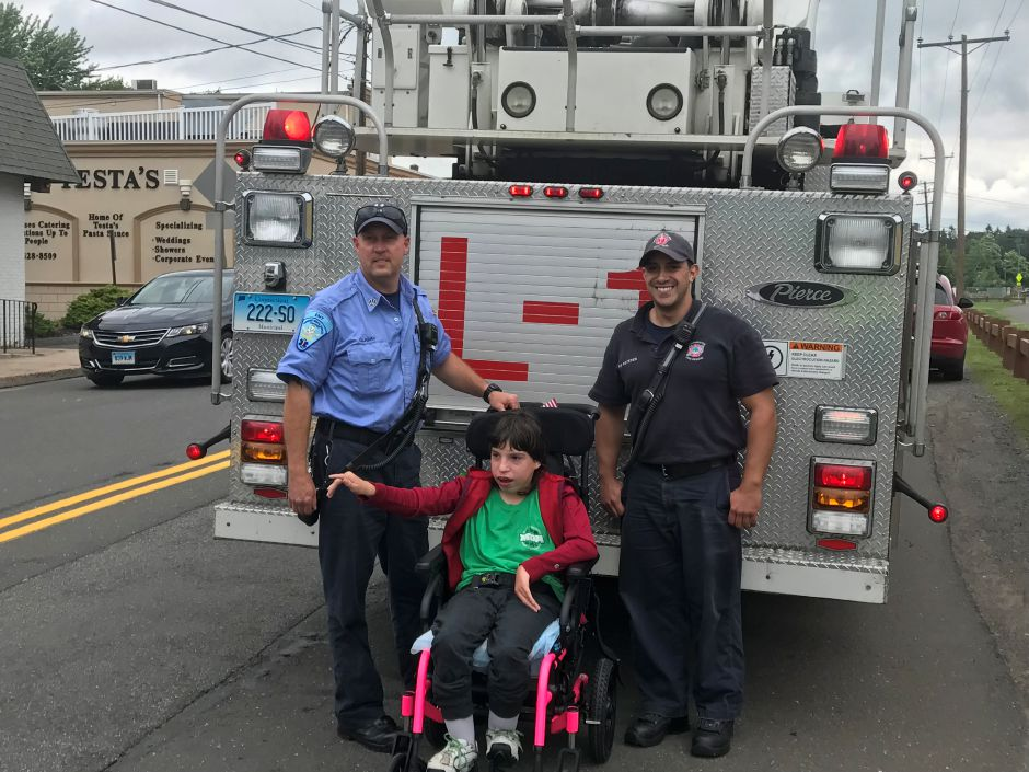 Members of the Southington Fire Department during the Fill a Boot event on June 19 with MDA Ambassador Dakota (Courtesy of Southington Firefighter Dan Comen)