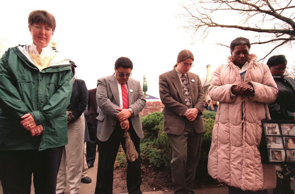 RJ file photo - State Rep. Mary Mushinsky, left, union representative Sirlester Parker and Pauline Taylor of East Hartford, in long coat, were among those attending the MLK Day rally in Wallingford April 20, 1999.