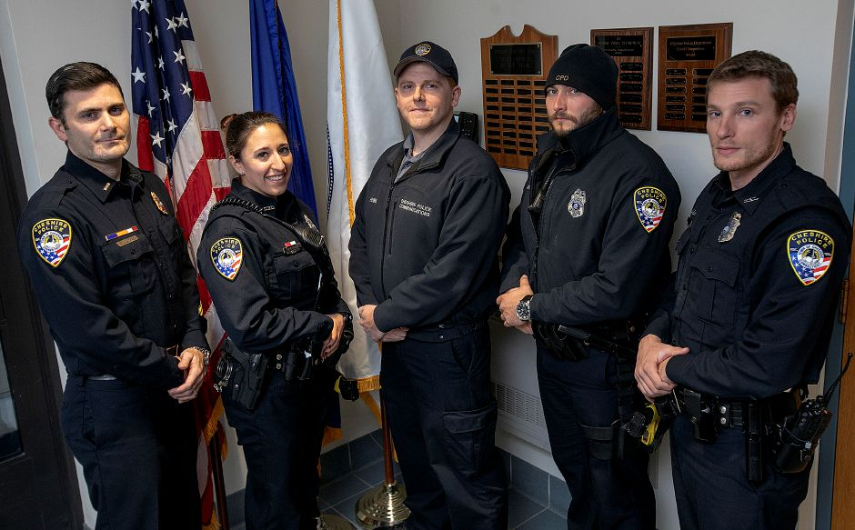 Left to right, Lt. Mike Durkee, officer Alysha Pirog, dispatcher Ron Henri, officer Mike Aquilino and officer Vincent Nastri stand in the Cheshire Police Deptartment on Friday. Five officers and two dispatchers were recognized for their actions during an officer-involved shooting earlier this year. Dave Zajac, Record-Journal