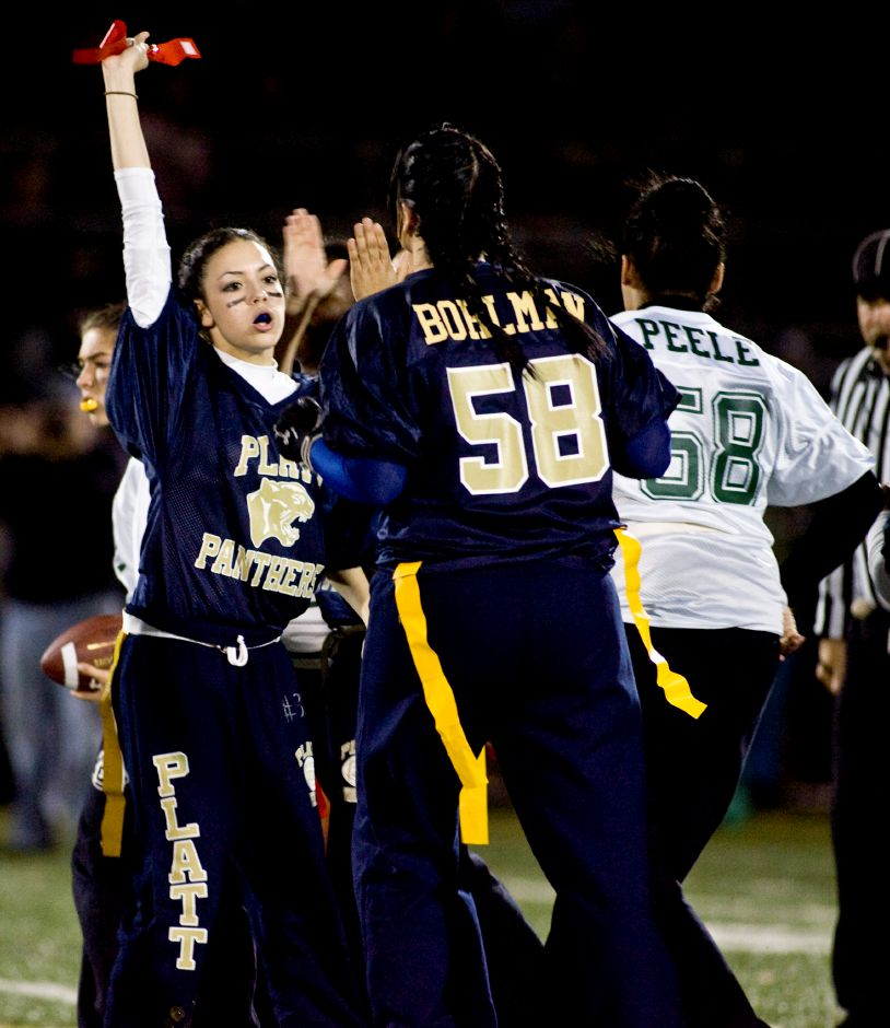 Platt defender Yesenia Hernandez (37) holds up a Maloney flag she pulled from Maloney