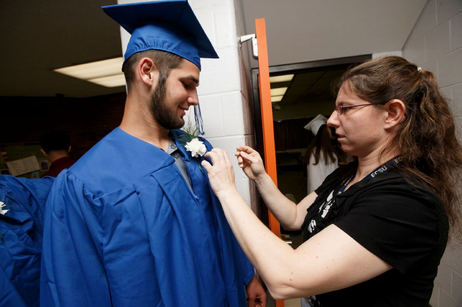Tyler Kuczynski gets help with his corsage from Kasia Kalinowski Thursday during Southington High School Graduation ceremonies at Southington High School in Southington June 21, 2018 | Justin Weekes / Special to the Record-Journal