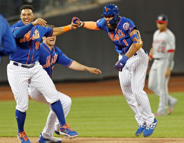 New York Mets Carlos Gomez, left, celebrates with the Mets Amed Rosario (1) after the Mets defeated the Washington Nationals 6-5 on Rosario