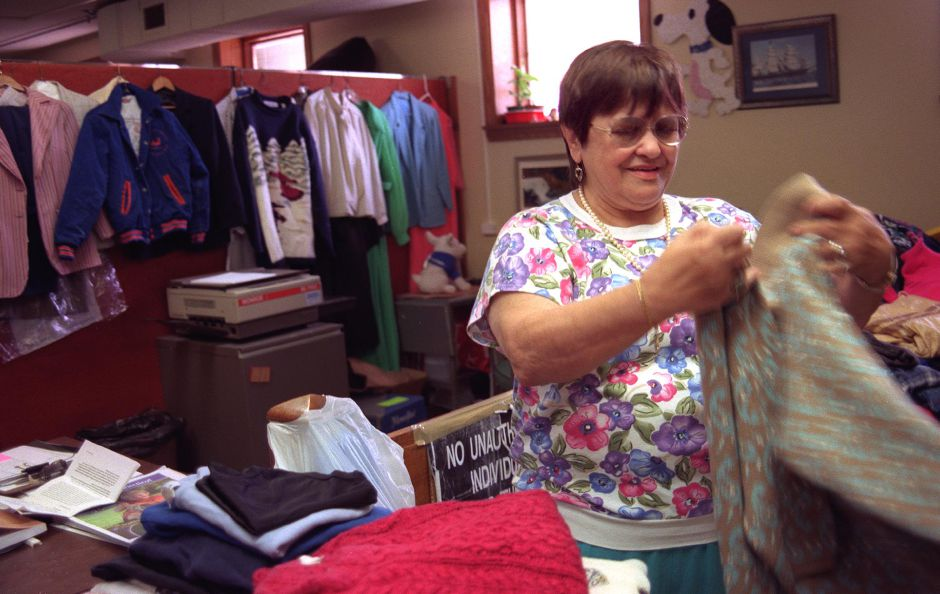 Rita Bartlett organizes some of the clothing that is in the Welfare Office in the Town Hall for those who may need it, Aug. 6, 1999. Rita has been working there for sixteen years, and is now feeling ready to retire.
