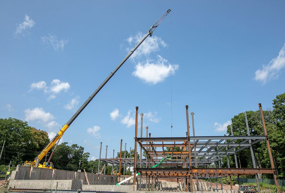A crane lowers a beam into place as construction continues on the Hartford HealthCare medical facility on South Main Street in Cheshire, Wednesday, August 15, 2018. Dave Zajac, Record-Journal