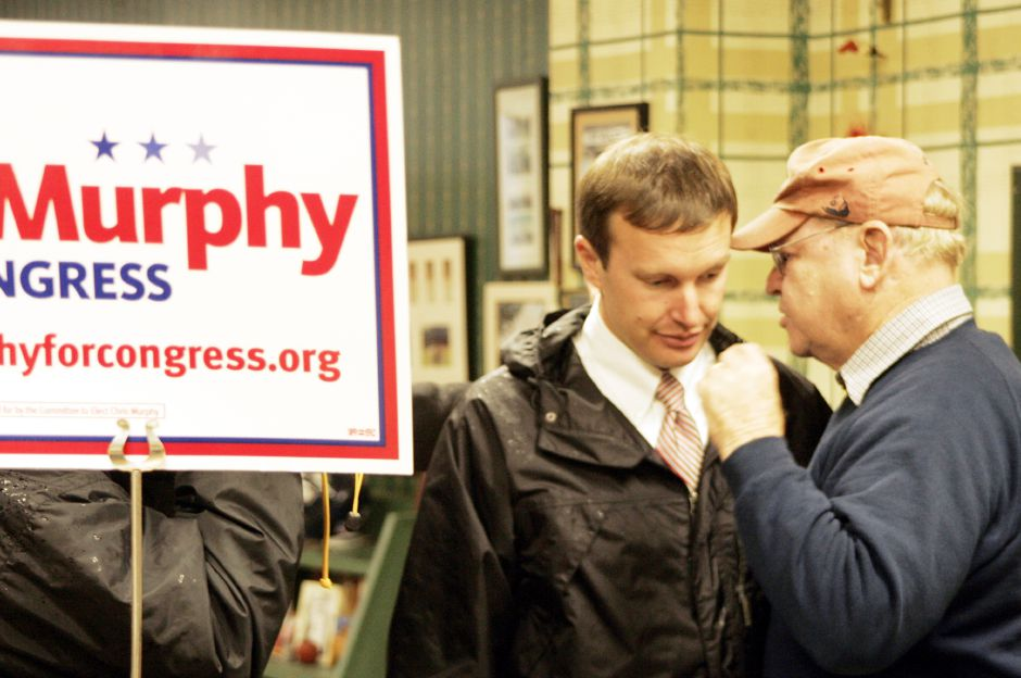 Frank Donovan, right, congratulates Chris Murphy on his victory over Nancy Johnson at Fischer