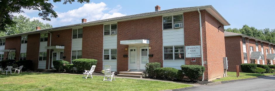 Two mid-century apartment buildings for sale in Wallingford