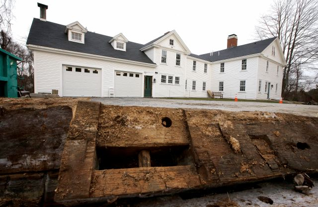 In this Thursday, Dec. 13, 2018 photo, a discarded beam rests in the driveway of the home where Sarah Clayes lived, in Framingham, Mass., after leaving Salem, Mass., following the 1692 witch trials. Clayes was jailed during the witch trials but was freed in 1693 when the hysteria died down. (AP Photo/Steven Senne)