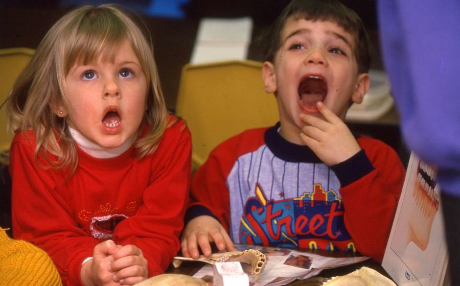 RJ file photo - Elizabeth Almeida, left, and Chris Roth, both 4, open their mouths wide during a class in dental hygiene taught by Bossy Flossy at the YMCA on Cornwall Avenue in Chesire, March 1, 1994.