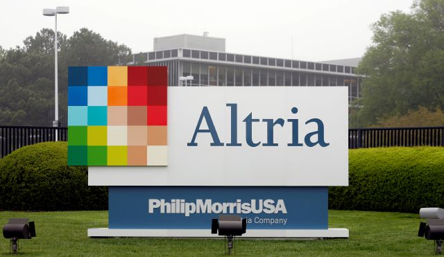 FILE - This April 23, 2008, file photo, shows the Altria Group Inc. corporate headquarters in Richmond, Va. Altria is spending about 12.8 billion for a stake in e-vapor company JUUL as one of the world's biggest tobacco companies tries to offset declining cigarette use. (AP Photo/Steve Helber, File)