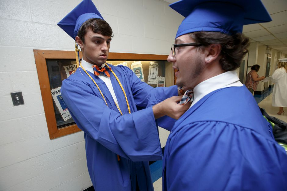 Patrick Doherty helps Nicholas Savolis with his bow tie Friday during Lyman Hall High School