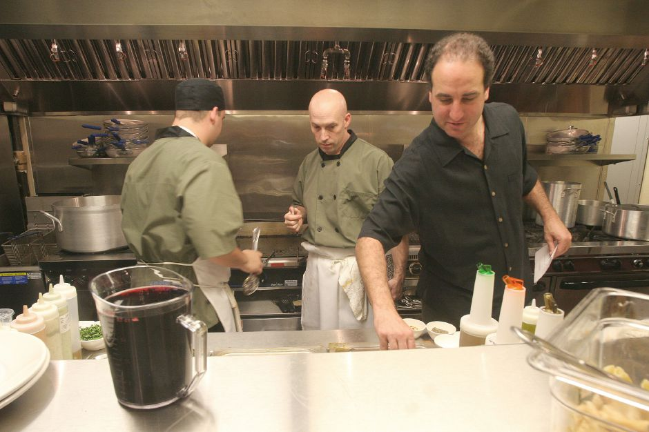 Record Journal Photo/ Johnathon Henninger 11.27.07 left to right, Zach Willette, cook, Eddie Dwyer, Executive Chef, and Barry DePaolo, owner of Bonterra Italian Bistro and Anthony Jack