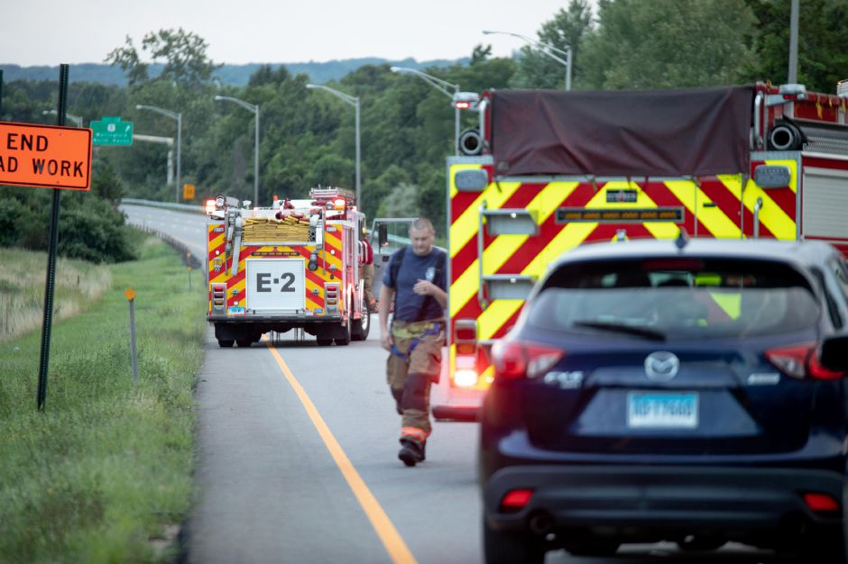 A portion of Interstate 91 was closed and traffic stopped Sunday afternoon following a crash involving a motorcycle and at least three other vehicles near exit 13 in Wallingford. | Devin Leith-Yessian/Record-Journal