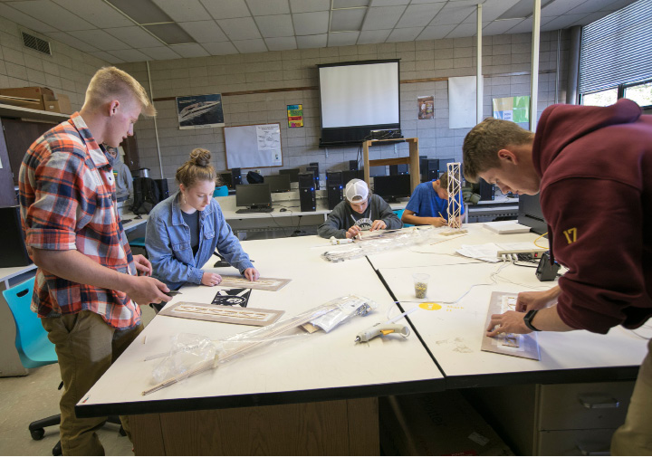 Students work in a technical education class at Sheehan High School in Wallingford last week. Left to right are Martin Seibt, 16, Bridget O'Connor, 17, Jake Festa, 16, Ryan Carey, 15, and Camden Wallace, 18.    | Photos by Dave Zajac, Record-Journal