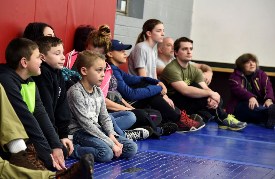 Particpants of various ages listen as Robert Rand, owner of Krav Maga Southington, teaches them how to stay safe in an active shooter senario, at Krav Maga Southington in Plantsville Friday, Feb. 23. | Bailey Wright, Record-Journal