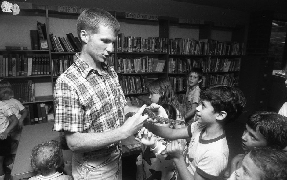RJ file photo - Naturalist Eric Nelson introduces a snake to spectators at the Cheshire Public Library July 18, 1989.