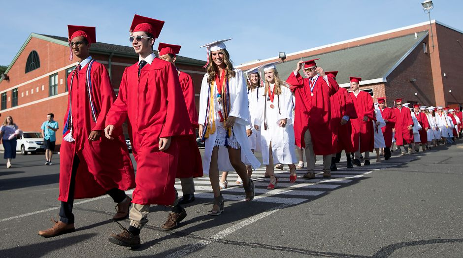 Class President Raj Dhage, far left, and Kevin Lenoce lead the Classof 2017 to graduation ceremonies at Cheshire High School, Wednesday, June 14, 2017. | Dave Zajac, Record-Journal