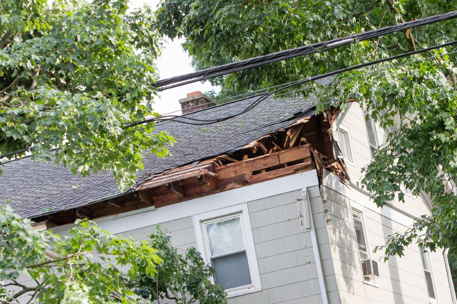 Damage to the corner of a house on Ward Street where a tree limb fell during a thunder storm Tuesday in Wallingford Jun. 23, 2015 | Justin Weekes / For the Record-Journal