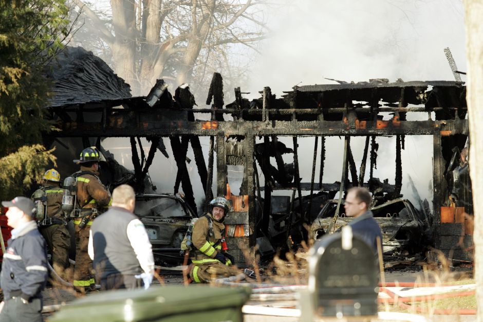House fire in Southington on Meriden-Waterbury Turnpike Tues. afternoon, Jan. 9.