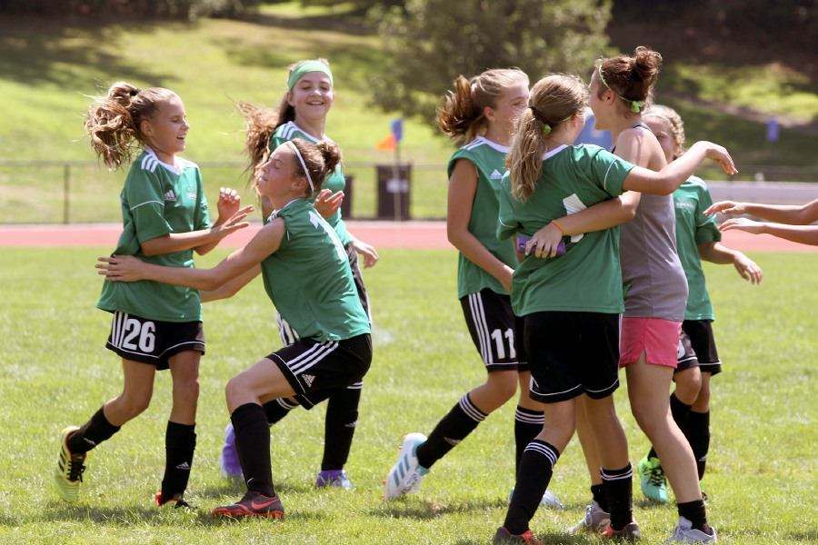 The WYSL Strikers celebrate their win over Brazil CT Yellow during the TWIST U12 girls championship game. Photos by Aaron Flaum, Record Journal