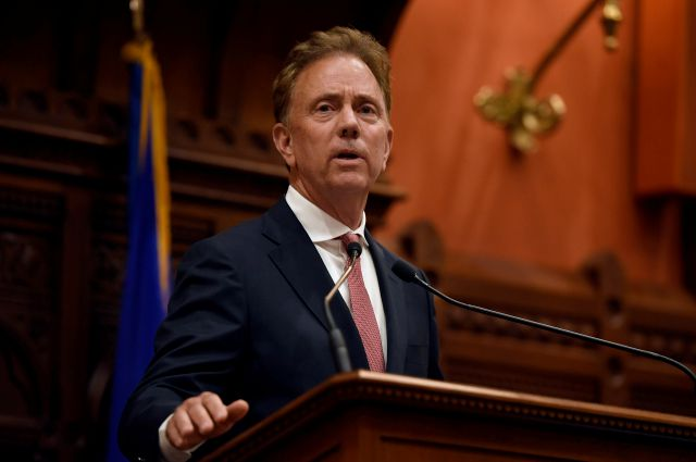 Connecticut Gov. Ned Lamont addresses the House and the Senate at the State Capitol in Hartford, Conn., Thursday, June 6, 2019. (AP Photo/Jessica Hill)