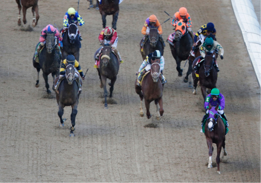 Victor Espinoza, front right, rides California Chrome to victory during the 140th running of the Kentucky Derby horse race at Churchill Downs Saturday, May 3, 2014, in Louisville, Ky.  (AP Photo/Charlie Riedel)