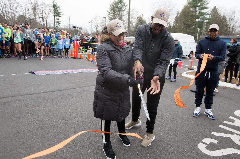 Cyrus Damon and Julie Rodriguez of AWB cut the ribbon to start the 5K Saturday during the Hot Coco 5K to benefit Abilities Without Boundaries at the Norton Elementary School in Cheshire November 18, 2017 | Justin Weekes / For the Record-Journal