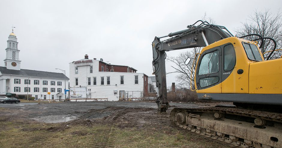 Construction equipment sits Friday on the site of a future auto parts store at the corner of East Main  and Broad streets in Meriden.