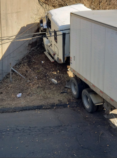 Pond Hill Road in Wallingford was closed Sunday morning after a tractor trailer traveling north on Interstate 91 left the right side of the highway and struck the opposite side of the overpass foundation. | Image courtesy of Connecticut State Police