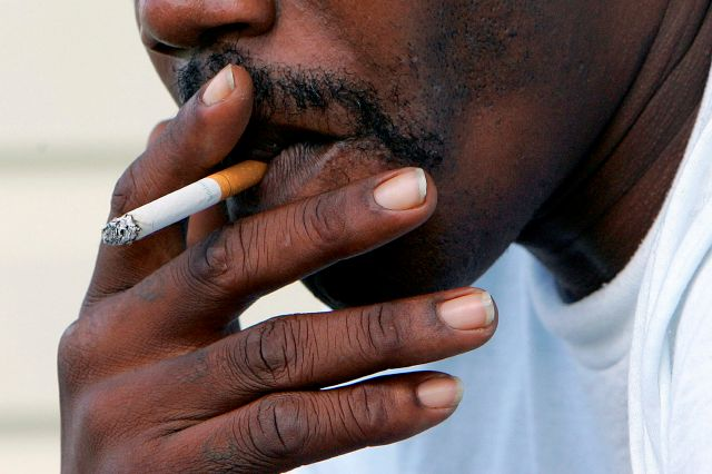 FILE - In this Oct. 4, 2005 file photo, a man smokes a cigarette in Euharlee, Ga. (AP Photo/Ric Feld)