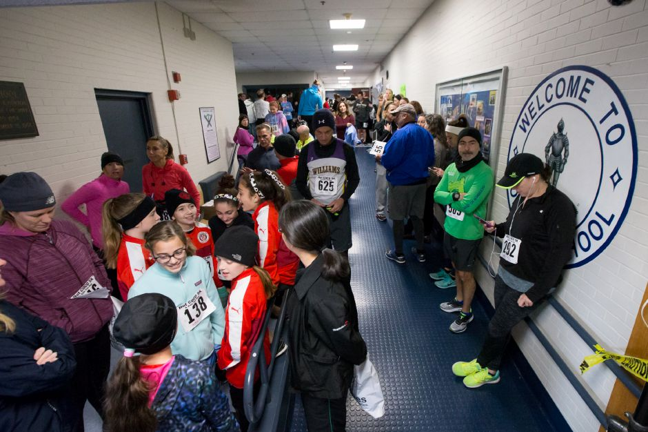 Runners gather in the school to stay warm before the start Saturday during the Hot Coco 5K to benefit Abilities Without Boundaries at the Norton Elementary School in Cheshire November 18, 2017 | Justin Weekes / For the Record-Journal