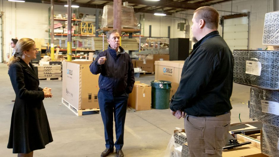 Democratic Gubernatorial candidate Ned Lamont and Lt. Gov. candidate Susan Bysiewicz speak with James Star, manager of Trinity Solar in Cheshire. Joined by Democratic Senator Chris Murphy, they toured the company and spoke about the importance of clean energy on Oct. 25, 2018. | Devin Leith-Yessian/Record-Journal