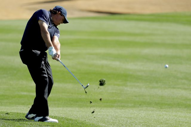 Phil Mickelson hits from the fairway on the third hole during the third round of the Desert Classic golf tournament on the Stadium Course at PGA West on Saturday, Jan. 19, 2019, in La Quinta, Calif. (AP Photo/Chris Carlson)
