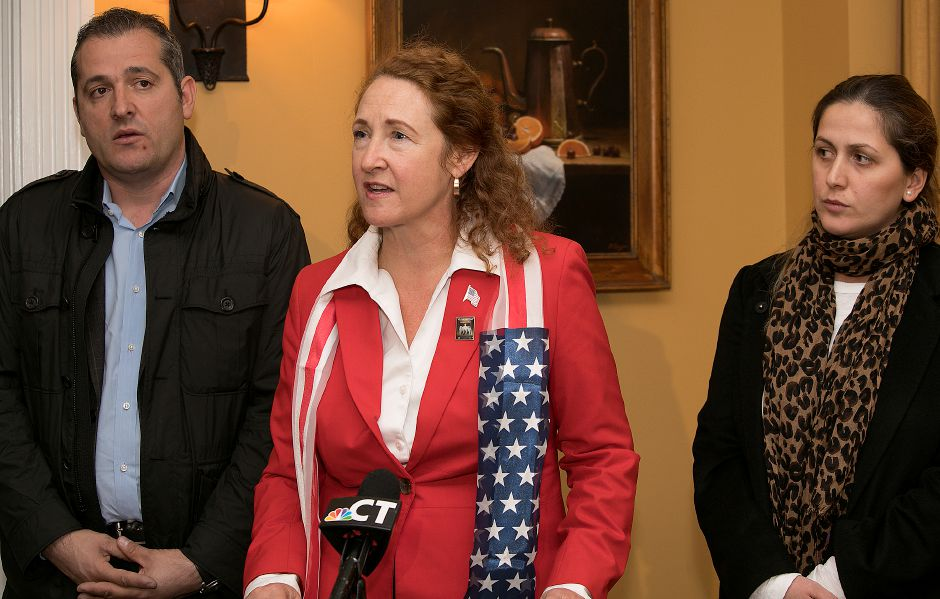 FILE PHOTO: U.S. Rep. Elizabeth Esty speaks during a press conference at Viron Rondo Osteria in Cheshire, Friday, Nov. 10, 2017. Denada Rondos, right, who came to the United States in 2002 and helps run Viron Rondo Osteria with husband Viron Rondos, left, faces deportation back to Albania. | Dave Zajac, Record-Journal