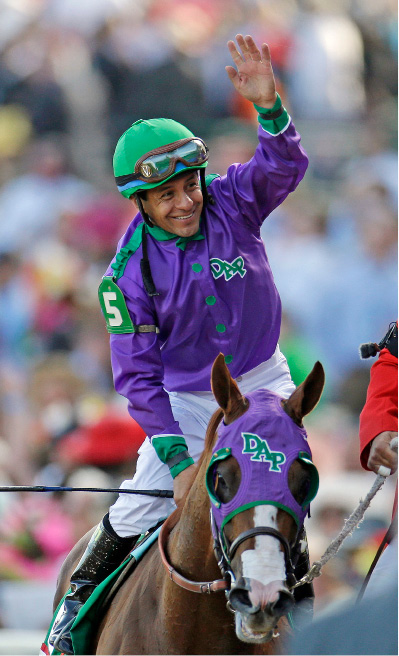 Victor Espinoza celebrates after riding California Chrome and winning the 140th running of the Kentucky Derby at Churchill Downs in Louisville, Ky. on Saturday. | Associated Press