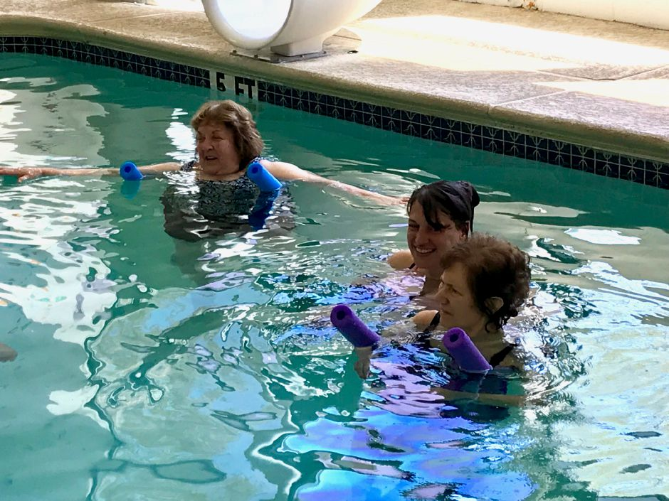 (L-R) Instructor Phyllis Drescher, Lauri Kapozzi and Jane Pinciaro during a Parkinson's aquatic exercise class in the therapy pool at the Wallingford YMCA, 81 S. Elm St., Wallingford. |Ashley Kus, Record-Journal