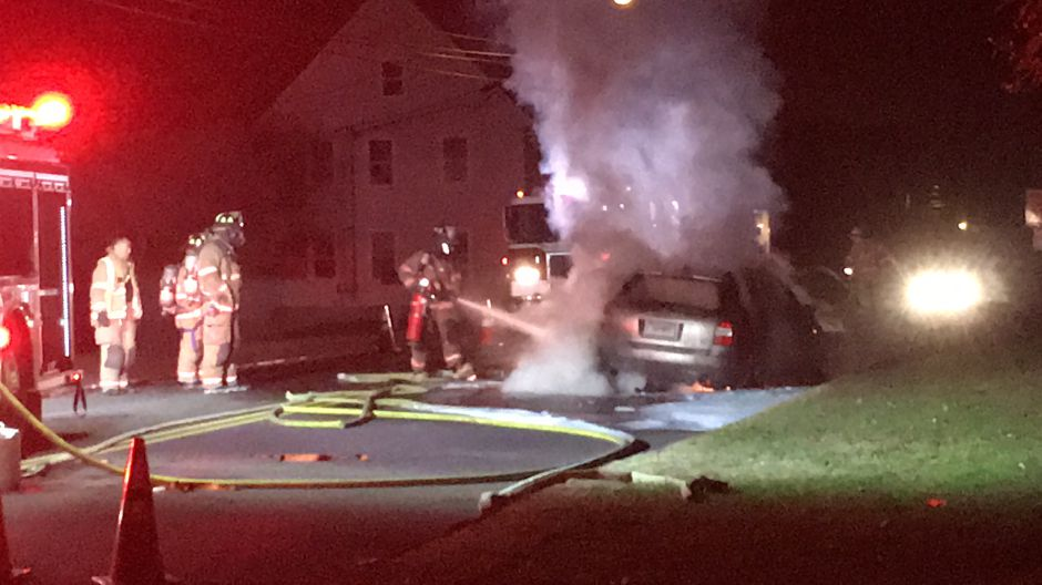 A vehicle fire erupted on North Elm Street on Tuesday, Oct. 17, 2017. | Lauren Takores, Record-Journal