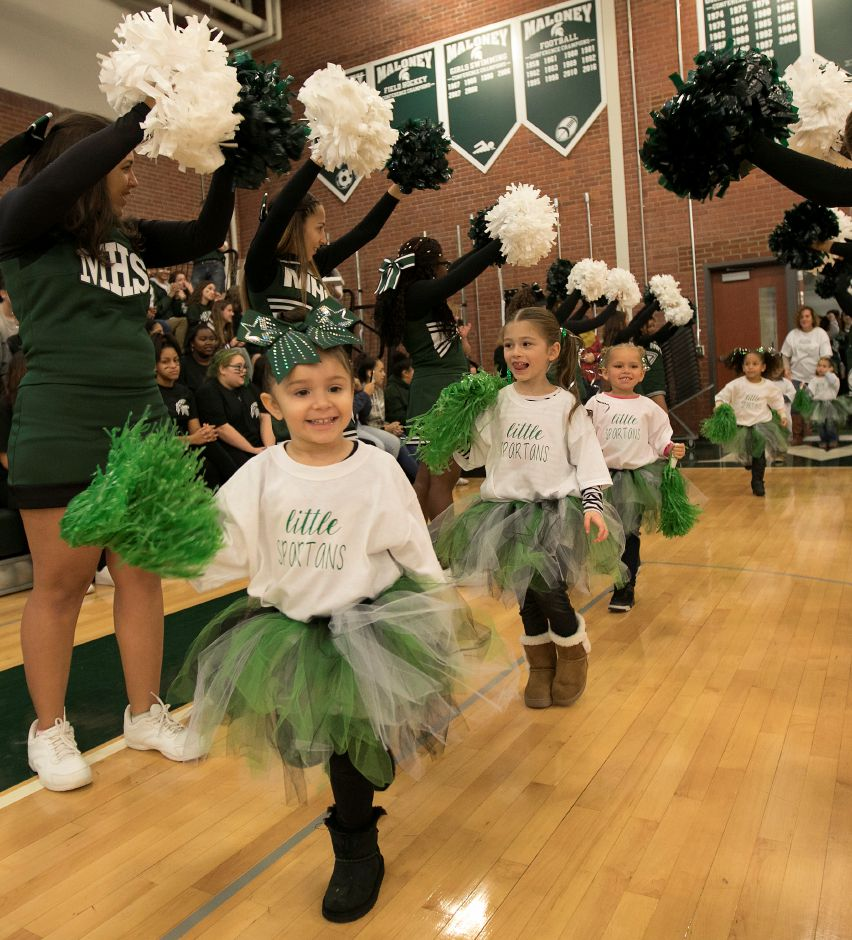 Natalya Muniz, 3, of Meriden, and the Little Spartans get a cheer upon entering the annual pep rally at Maloney High School in Meriden, Wednesday, Nov. 22, 2017. | Dave Zajac, Record-Journal