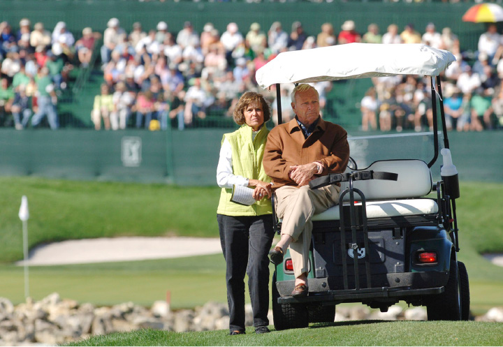 FILE - In this March 17, 2007, file photo, Arnold Palmer, right, and his wife, Kit, watch golfers teeing off from behind the 16th tee during the third round of the Arnold Palmer Invitational golf tournament in Orlando, Fla. The first Arnold Palmer Invitational since his death will feature strong emotions for some, stories for all and reminders of the King at just about every turn. (AP Photo/Phelan M. Ebenhack, File)