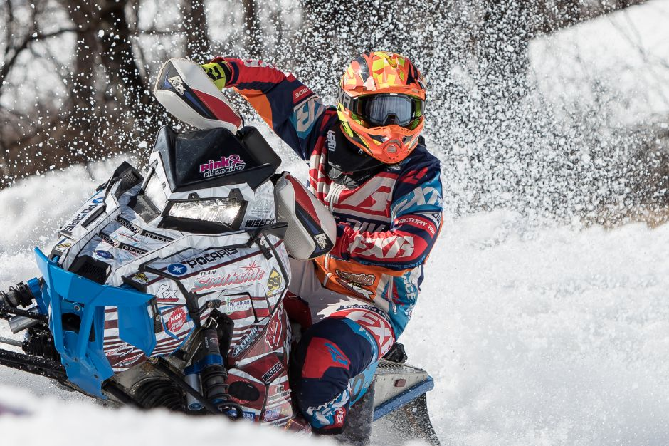 Kolton Gillilan, 15, of East Fairfield, Vermont, eyes the checkered flag, winning his race Saturday during the East Coast Snocross Series race at Mount Southington. For more photos, visit www.myrecordjournal.com. Justin Weekes, special to the Record-Journal