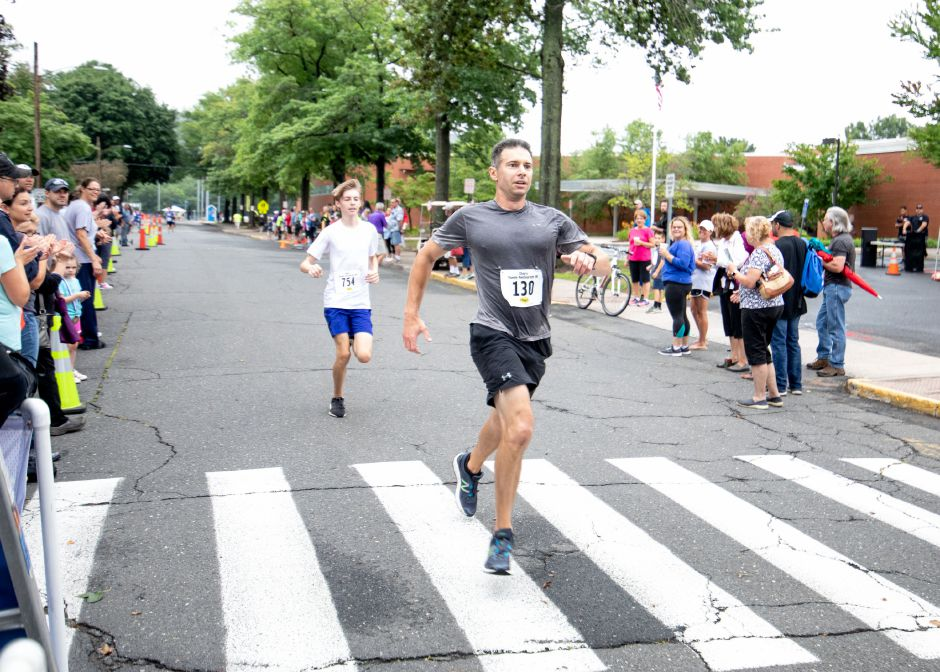 Runners close in on the finish line of the Chip's Family Restaurant 5k Road Race. The Petit Family Foundation holds the race every year to raise money for the foundation