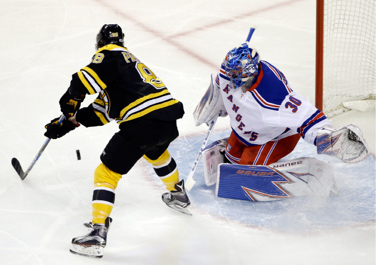 Boston Bruins right wing David Pastrnak (88) shoots the puck but can