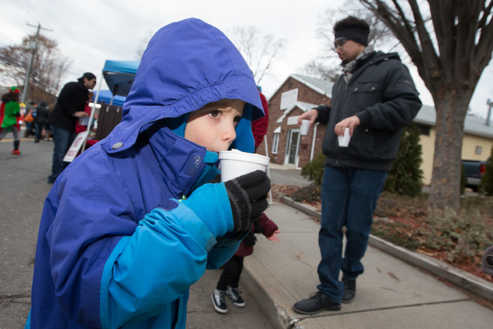 Henry Koch 6 of Meriden sips hot chocolate Saturday during Christmas in the Village in South Meriden Dec. 3, 2016 | Justin Weekes / For the Record-Journal