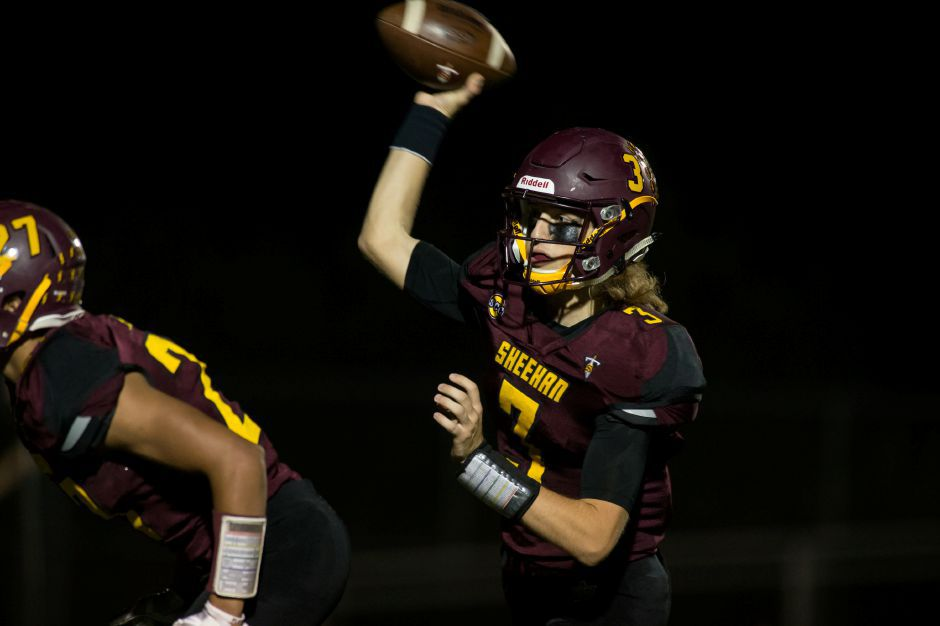 Sheehan quarterback Wes Terzi threw for five touchdowns Friday night as the Titans improved to 3-0 with a 62-20 SCC Tier 3 victory in Guilford. | Justin Weekes / Special to the Record-Journal
