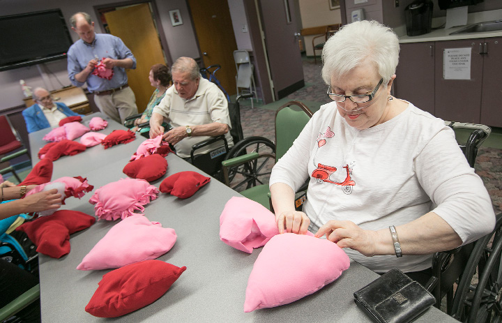 Marie Reynolds and other seniors make heart pillows at the Miller Memorial Community in Meriden, Wednesday, April 19, 2017. The pillows will be delivered to the Connecticut Children
