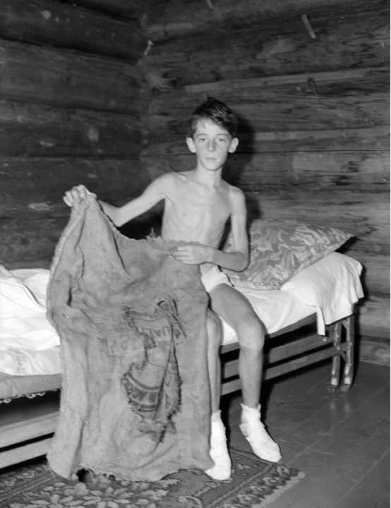 Donn Fendler, 12, of Rye, N.Y., is shown with the sack which he used as a sleeping bag while he wandered for eight days in the wilds of Maine.  A Boy Scout, Donn used to good advantage, the wood-lore taught in the organization. Donn disappeared near the shrouded summit on  Mount Katahdin.  The boy was found by campers at Stacyville, Maine, July 16, 1939, 35 miles from the point where he became lost 8 days earlier.   (AP Photo)