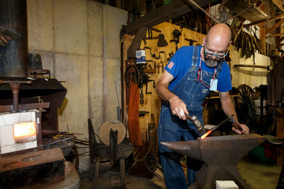 Rick Bihlmeyer works on a piece of steel Saturday during the 99th Durham Fair on the Durham Fairgrounds in Durham September 29, 2018 | Justin Weekes / Special to the Record-Journal