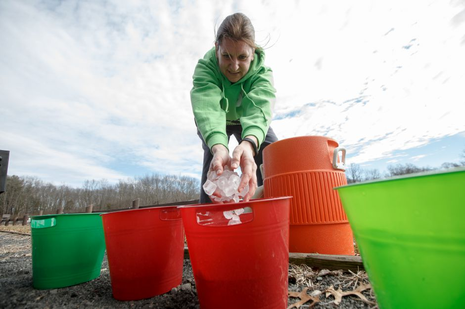 Lisa Zaborowsi prepares buckets with ice Saturday during the 4th Annual Ice Bucket Challenge to raise money for Camp Quinnipiac at Bartlem Park in Cheshire February 24, 2018 | Justin Weekes / Special to the Record-Journal